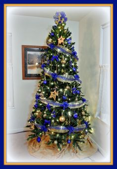 blue and gold christmas tree this one is for my husband who retired from