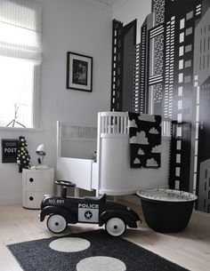 For a more retro royal this monochrome nursery is a fabulous contemporary design.  This cityscape wallpaper works fabulously with the modern cot and side table.  Furthermore, as this little city slicker grows, this design can be easily adapted for the older toddler or child.