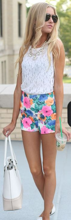 White lace top, floral shorts, white bag and ballerinas. Pretty summer look.