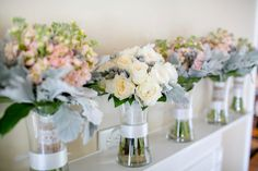 Bridal and bridesmaid bouquets. Peach, grey, white. Patience roses.  Carley Rehberg Photography