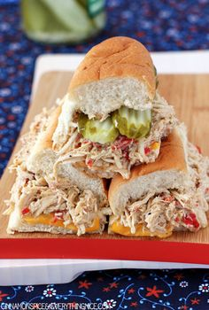 Slow Cooker Chicken Cheesesteaks.  Slow-cooked seasoned chicken breasts piled high on toasted rolls with cheese, roasted red peppers, jalapenos,
