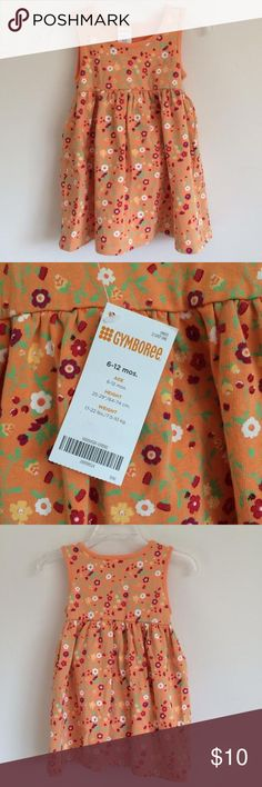 Girls Gymboree Dress 6-12 Months This sleeveless tank dress has a red, white, and yellow floral pattern on orange background. It is new with tags attached from a smoke free home and includes the diaper cover. Gymboree Dresses Casual