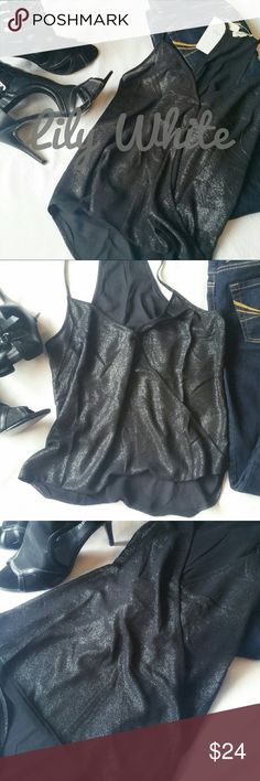 Lily White top Strappy sexy top from Lily White, size small. Shimmery and sparkly black flowy top, paired here with skinny jeans and heels for sexy night out. Also adorable under a cardigan for work! Versatile, wear anywhere top. Lily White Tops Blouses