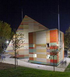 """""""Auditorium Aquila"""": Clad in larch wood strips, the same wood used for Stradivarius violins, the new auditorium and event spaces in earthquake-torn L'Aquila, Italy, are both temblor-resistant and acoustically efficient. The multi-hued cubes were pre-fabricated offsite and shipped flat-pack to the city's medieval castle grounds, replacing an auditorium destroyed during a 2009 quake.   Renzo Piano (2012)"""