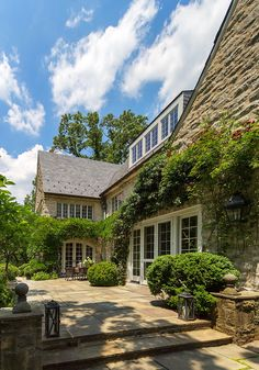Stone Cottage Patio Cottage Patio by Barnes Vanze Architects, Inc Cottage Patio, Tudor Cottage, Shingle Style Homes, Build Your House, Cottage In The Woods, Old World Charm, Classic House, Traditional House, Curb Appeal