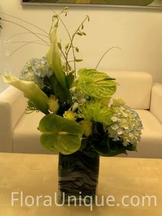 Sympathy arrangement going out today: hydrangea, anthurium, dendro orchid, calla lily, spider mum, hydroponic rose and green trick dianthus.