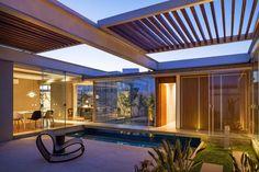 Casa das Pérgulas Deslizantes / FGMF Arquitetos Retractable pergola. Pinned to Garden Design - Pergolas by Darin Bradbury of BASK Landscape Design.