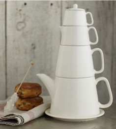 Teapot, teacup, creamer, sugar bowl, saucer - all stacked efficiently.