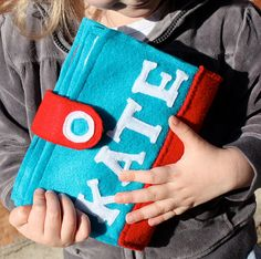 On The Go Book - book made of felt (cheap!), with 3 activities: dress-up (cloth paper doll), tic-tac-toe, and coloring.