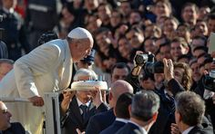 Pope Francis blows candles on a birthday cake on the occasion of his 78th birthday in St. Peter's Square and states there are limits to freedom of expression with regard to insults to another person's religion.
