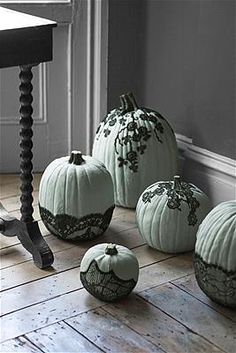 Veiled BeautyPart cobweb, part creeping vine, the effect of black lace on painted pumpkins is thoroughly macabre. Begin by painting pumpkins (or faux Funkins, from $18; funkins.com); we opted for Farrow & Ball's Green Blue. Once they're dry, use our photo (left) as a guide to cut out pieces of lace; brush matte Mod Podge onto the back sides, and adhere to your pumpkins. Finish by sealing each with a topcoat of Mod Podge.