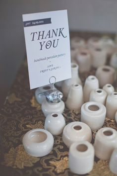 This bride made ceramic bud vases for her guests, how cool!