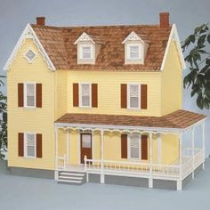 this looks a lot like a house in my childhood neighborhood....when I am a real adult, I really want to decorate/furnish a dollhouse. maybe this one.