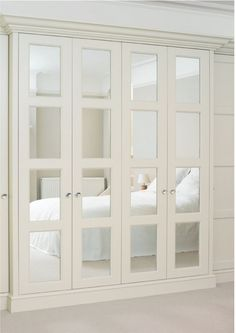 I REALLY like the idea of having closet doors that open accordion-style like these, but it would probably be impractical since the door to the spare bedroom opens against the closet doors.