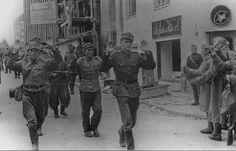 Soviet soldiers escort Finnish prisoners of war, 1944