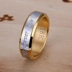 Ring (Love band) A beautiful way to express your love with this beautiful forever love ring..excellent for occassions like Valantine, Birthday. Made of stainless steel with 18k gold plated. Wt. 6.5 grams.  Available limited qty. Jewelry Rings