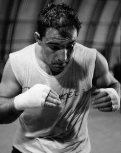 World heavyweight champion Rocky Marciano . April 1956 he announced his retirement from boxing. Marciano, undefeated in 49 profess. Mma Boxing, Boxing Workout, Boxe Fight, Muay Thai, Boxing Posters, Professional Boxing, Heavyweight Boxing, Ufc, Boxing History