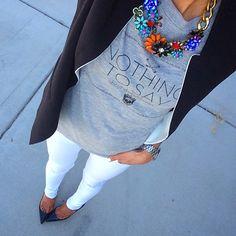 Black blazer + graphic tee + white jeans + black pumps + statement necklace