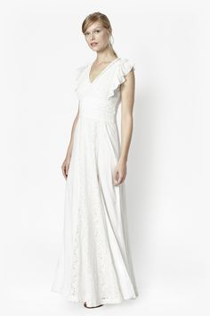 """<ul> <li> Long lace maxi dress with split leg and loose frilled sleeves</li> <li> Cut-away back with zip-up fastening</li> <li> Crochet-inspired detailing extending down the length of the dress and around the waist</li> <li> V-shaped neckline and soft lined interior</li> <li> UK size 10 length is 154cm</li> </ul>  <strong>Our model is 5ft 9.5"""" and is wearing a UK size 10.</strong>"""