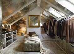 closet....ah, what a dream  Attic walk-in closet    What's a clothes horse to do when their bedroom closet is ready to burst? Take your wardrobe to the attic and create a posh, walk-in closet. This converted attic space combines lush fabrics, luxurious seating, and decorative, mirrored wall accents that open up the area. Even though the walls are lined with clothes, there's still plenty of room to twirl around in your finest.