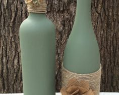 Teal chalk painted wine bottles, set of 2, wound with polished hemp twine and embellished with metal flowers in teal and brown. These recycled bottles would make a great wedding centerpiece or house-warming gift. Or adorn your own fireplace mantel or shelves with the color you love. Message me for custom or large orders.Orders of 10 or more bottles recieve a discount.