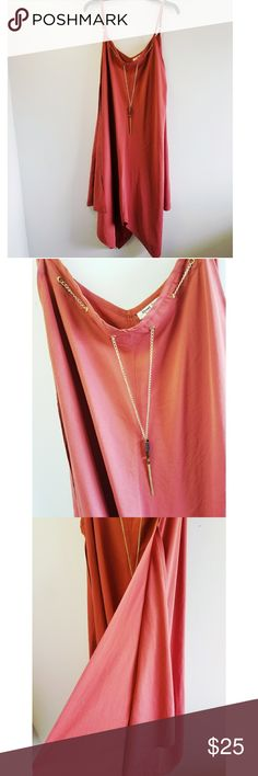 Speed Control New York Dress Rust colored dress with adjustable spaghetti straps. V shaped neckline with a gold chain embellishment attachment. Handkerchief style hem. 100% polyester. Hand wash and line dry. Great condition! Speed Control New York Dresses