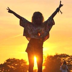 Peace sign since the hippie culture. Think this must be a photo at 'The Burning Man'