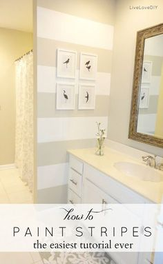 How to paint stripes - the easiest tutorial ever! I love the colors and pictures on the wall of this bathroom. I think this would look good in our upstairs bathroom. Lord knows that room needs a makeover!