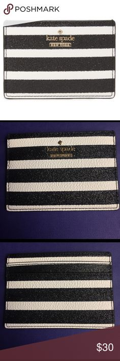 NWOT KATE SPADE CARD CASE BRAND NEW - NEVER WORN. A slim Kate Spade New York card case accented with glittering stripes. 2 exterior card slots and center pocket. Fits well into any bag, backpack, or the back pocket of your fav jeans. SAME DAY SHIPPING! 🌸🌸🌸PLEASE FEEL FREE TO ASK ANY QUESTIONS OR TO MAKE AN OFFER🌸🌸🌸 Measurements Height: 2.75in / 7cm Length: 4in / 10cm kate spade Bags Wallets