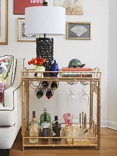 A bar cart doubles as a side table in this small apartment with big style #hgtvmagazine http://www.hgtv.com/decorating-basics/decorating-ideas-for-small-spaces/pictures/page-4.html?soc=pinterest