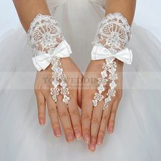 Wristlength Fingerless Ivory Lace Wedding Gloves with Satin Bow
