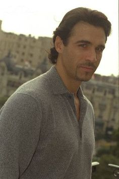 Adrian Paul.  Highlander!  Even if he's not Scottish, he played one!