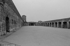 Inmates at Mauthausen (pictured), Austria's largest concentration camp, were made to carry granite blocks up the 186 steps of the 'Stairway of Death' in brutal 12-hour shifts