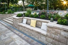 Recreate your outdoor space with Cambridge Pavingstones with ArmorTec! Installation by: Mike Pantina Masonry Sloped Backyard Landscaping, Backyard Retaining Walls, Sloped Garden, Backyard Pool Designs, Backyard Patio, Retaining Wall Steps, Retaining Wall Design, Backyard Seating, Banco Exterior