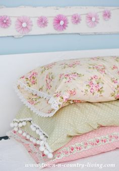 Lace trimmed vintage style pillow cases. See how to make your own! Pretty prints create cottage style appeal.