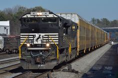 "NS SD70ACe number 1111, dubbed the ""bar code unit"", leads intermodal train 237 through Chamblee, Georgia. 237 originates in Charleston, S.C., works the South Carolina Inland Port in Greer, and terminates at Inman Yard in Atlanta, crossing the entire Piedmont Division in less than a day's time. www.nscorp.com"
