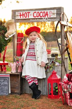 Christmas Mini Session Photos Taken Outdoors With A Hot Cocoa Stand Tree And
