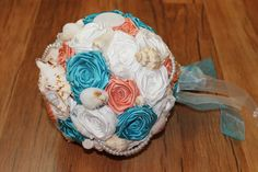 From the depths of the ocean blue, this beach shell wedding bouquet is a glorious accessory to carry down that aisle. Custom handmade from start to