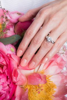 If you're all about the details, then your manicure will factor into that. You can't just wear any old pink or blush — it needs to perfectly complement your rings, skin tone, and, of course, the bouquet! Like this Just Peachy color