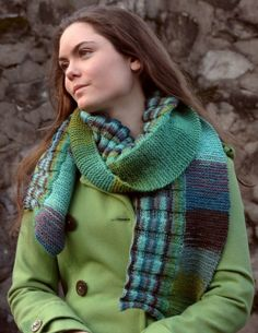 A colorful scarf with a split personality. Worked in two halves and two stitch patterns, garter and rib, it shows off the yarn's self-striping. Free pattern..