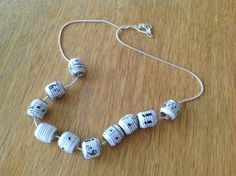 LOVE this idea! | Music notes Pandora style paper bead by MagdaCrafts on Etsy, £16.00