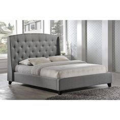 Set on wenge espresso legs, the Laguna Grey Upholstered Contemporary Platform Bed by LuXeo fuses timeless elegance with a hint of refined masculinity. The silvertone nail head trim adds an edgy appeal for a more modern look.