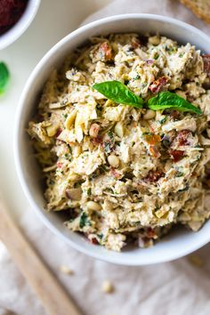 Mediterranean Greek Yogurt Chicken Salad - This creamy chicken salad is made with Greek yogurt, basil, artichokes, pine nuts and sun dried tomatoes for a quick and easy meal that is secretly healthy!