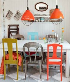 Love the painted chairs, the painted diamond floors and the orange lamps.