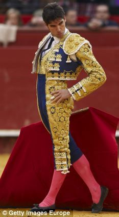 Spanish bullfighter Cayetano Rivera performs during a bullfight at the Plaza in Valencia