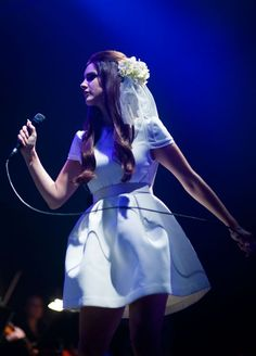 July 28, 2012: Donning a wedding dress ensemble, Lana Del Rey performs in a white mini backless dress and a white floral veil at Day 2 of the 2012 Splendour In The Grass Festival in Byron Bay, Australia.