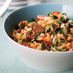 Rice Salad with Merguez and Preserved Lemon Dressing | This boldly flavored dish is enticing, especially to those with a taste for heat. It can be prepared several hours ahead and served at room temperature.