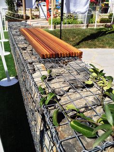 A Gabion Wall used as a bench in a garden setting