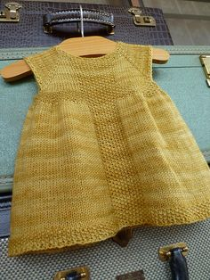 Knitting pattern for baby dress on RavelryRavelry: summer top made from scarf and crochet yoke - free pattern with charts.Ravelry: Rio Dress pattern by Taiga Hilliard so making this for the baby!I need to find someone who has a girl so I can crochet Knitting For Kids, Baby Knitting Patterns, Free Knitting, Ravelry Free Crochet Patterns, Toddler Dress Patterns, Beginner Knitting, Knitting Ideas, Knit Baby Dress, Knitted Baby Clothes