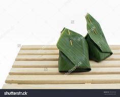 Sticky Rice With Steamed Custard, Wrapped In Banana Leaves Stock Photo 472125103…